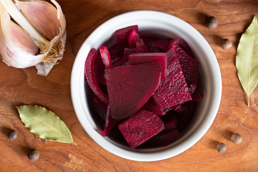 Fermented red beet in a bowl, top view