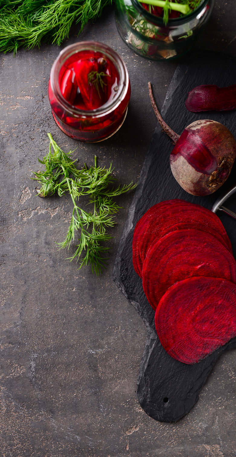 Cut fermented beetroot on grey table